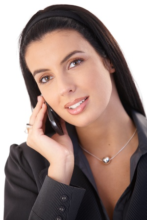 Closeup portrait of attractive businesswoman on mobile phone call, smiling. photo