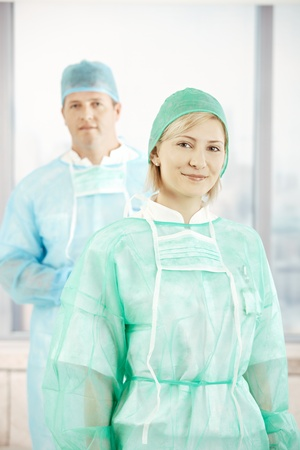 Portrait of smiling surgeons wearing scrub suit. Stock Photo - 8782837