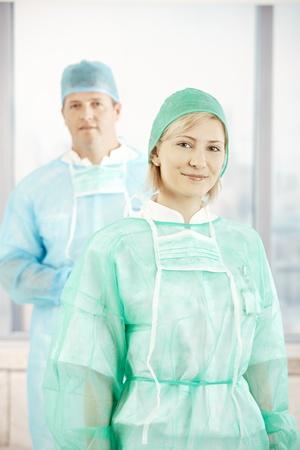 Portrait of smiling surgeons wearing scrub suit. Stock Photo - 8782837