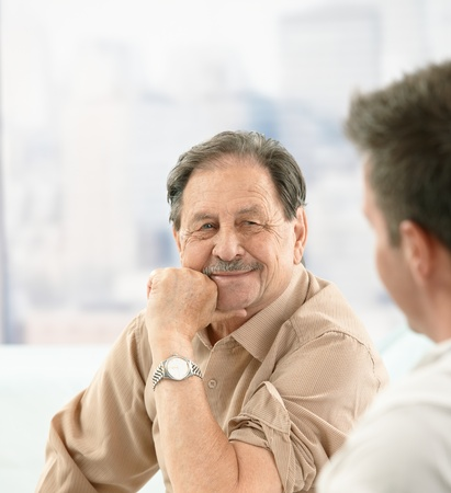 color consultation: Closeup portrait of older patient smiling at doctor on consultation.