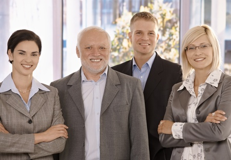 Portrait of smiling businessteam standing in office. photo