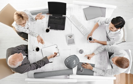 casual meeting: Team meeting from overhead view, businesspeople discussing work at office meeting table. Stock Photo