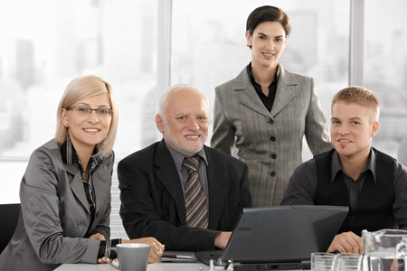 Team portrait of smiling businesspeople looking at camera in office. Stock Photo - 8783624