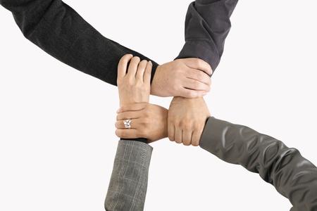 jornada de trabajo: Businessteam manos, s�lo manos closeup, expresando la unidad y el trabajo en equipo. Foto de archivo