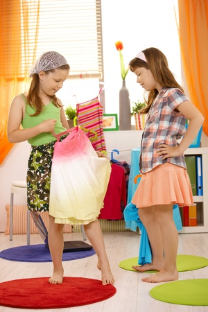 skirt up: Young girls having fun dressing up at home.