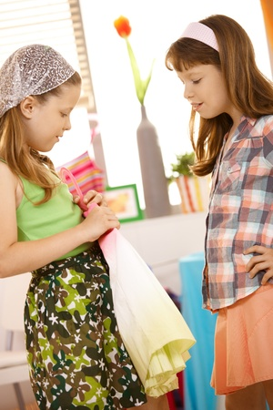 Little girl trying on skirt at home with friend. Stock Photo - 8784868