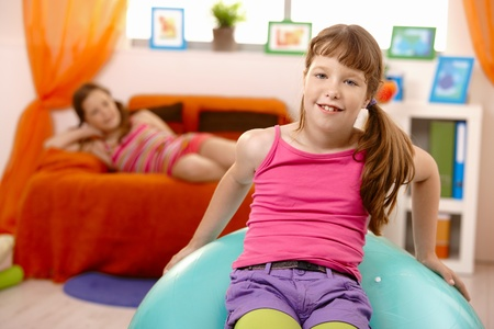 Schoolgirls at home, with gym ball, leisure time. Stock Photo - 8784372