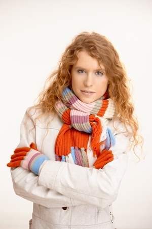 Pretty girl dressed up warm in scarf, gloves and coat. photo