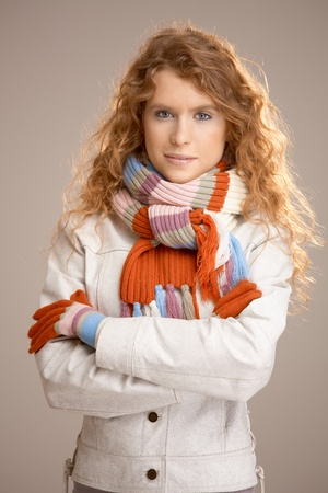 Attractive female dressed up warm in scarf, gloves and coat. photo