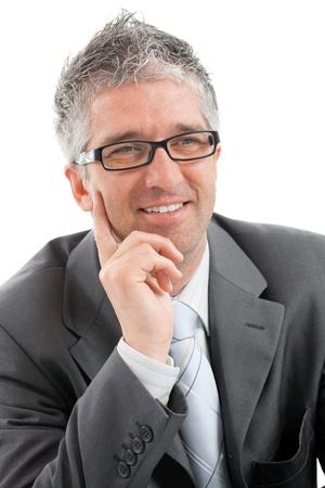 Portrait of happy businessman thinking, smiling. photo