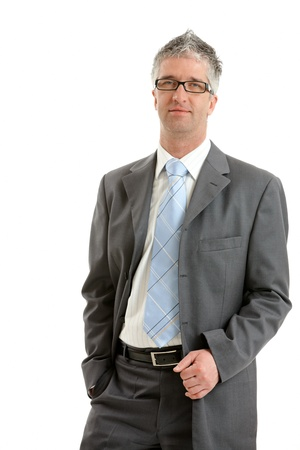 Portrait of serious businessman wearing gray suit with blue tie and glasses. Isolated on white background. photo