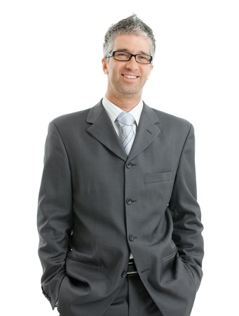 gratified: Portrait of businessman wearing gray suit and glasses, standing with hands in pocket, smiling.  Isolated on white background.