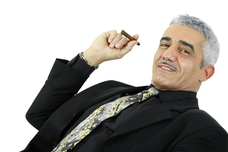 gratified: Portrait of confident businessman posing with cigar. Isolated on white.