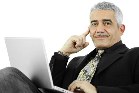 Casual businessman thinking leaning on hand, using laptop computer. Isolated on white. photo