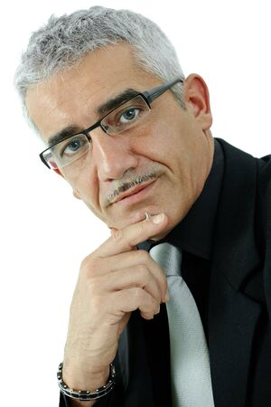 undoubting: Mature gray haired creative looking businessman thinking, isolated on white background.