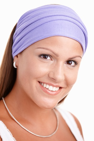 Portrait of attractive young woman, smiling, wearing headband. Stock Photo - 8908746