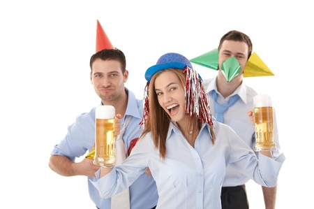 Young businesspeople having party fun in office over white background, drinking beer, laughing. photo
