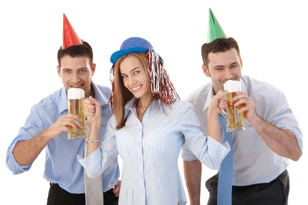 Young casual office workers having party fun after work, drinking beer, laughing. photo