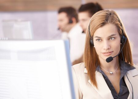 Portrait of beautiful female dispatcher working in call center. Stock Photo - 8951261