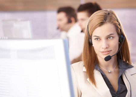 dispatcher: Portrait of beautiful female dispatcher working in call center.