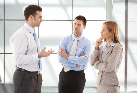 office lobby: Young attractive casual office workers talking in hallway. Stock Photo