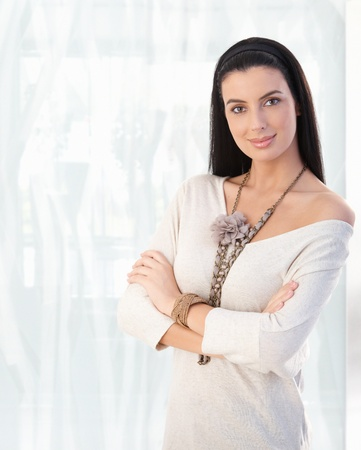 Portrait of young caucasian woman, looking at camera, smiling. Copy space on left. Stock Photo - 9066415