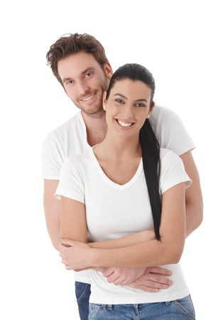 Portrait of happy young couple, hugging, smiling. photo