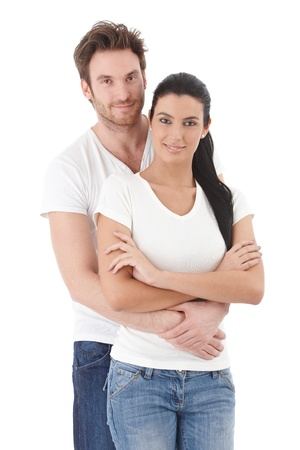 embracing: Portrait of attractive young couple smiling, hugging each other.