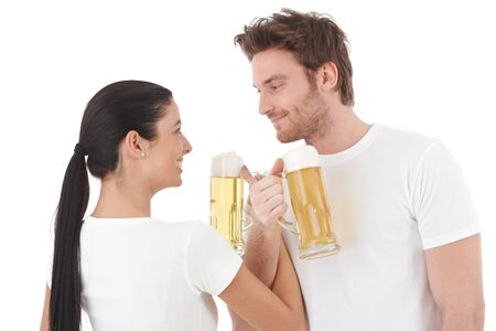 Young couple drinking to their close friendship, smiling. photo
