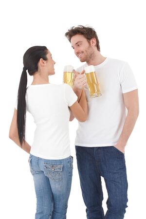 Young loving couple drinking to their close relationship, smiling, having fun. Stock Photo - 9201742