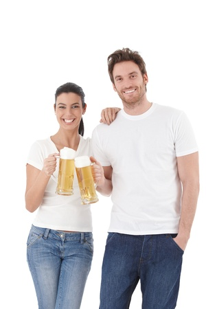 raise hand: Happy young loving couple clinking with beer, laughing.
