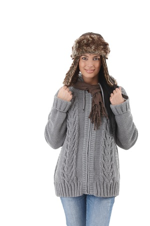 Young attractive woman wearing warm sweater, hat and scarf, smiling. photo