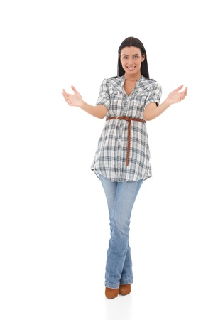 Attractive young woman holding an invisible heavy  object, smiling. photo