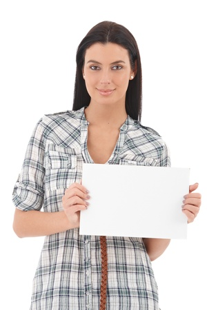 Portrait of confident young woman holding a blank sheet in her hands, smiling. photo