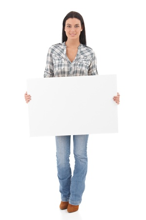 Attractive young girl holding a white panel in her hands, smiling. photo