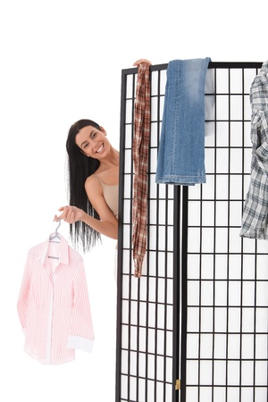Sexy young girl undressing behind dressing panel, smiling. Stock Photo - 9201788