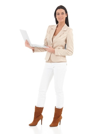 Confident young woman using laptop, smiling. photo