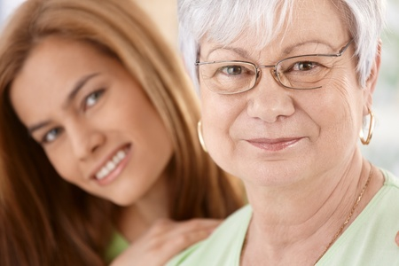 Closeup portrait of happy senior mother and young daughter, hugging, smiling. Stock Photo - 9209157