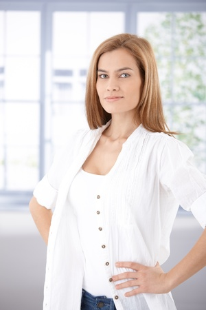 Pretty woman standing with hands on hips. Stock Photo - 9208648