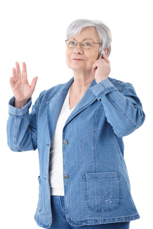 cutout old people: Mature woman chatting on mobile phone, smiling .