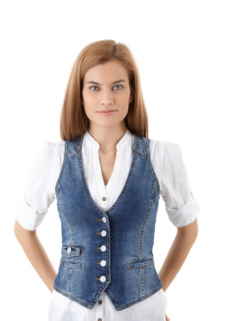 Beautiful young girl wearing denim waistcoat, smiling. photo