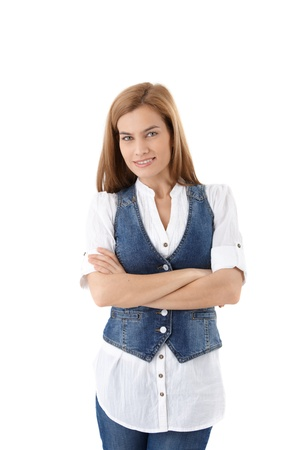 Pretty young woman standing arms crossed over white background. Stock Photo - 9208605