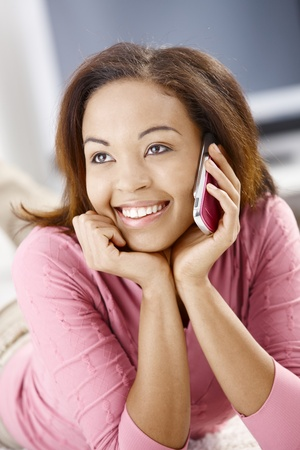 Portrait of cheerful girl using cell phone, smiling happily. photo