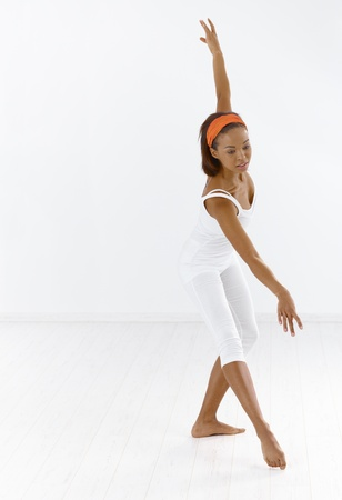 Afro ballerina dancing in studio, concentrating. Stock Photo - 9249482