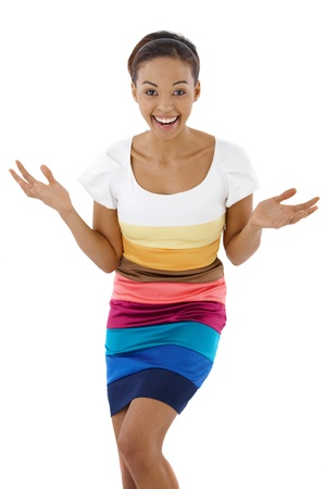 Surprised laughing ethnic girl in multicolour dress, looking at camera. photo