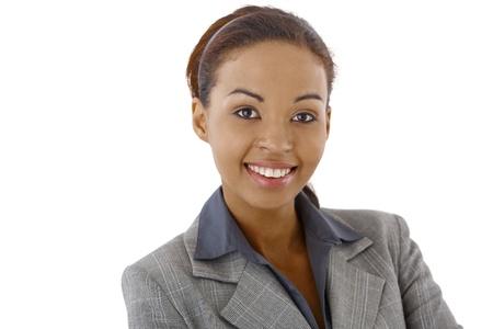 Closeup studio portrait of afro businesswoman smiling at camera. Stock Photo - 9263991