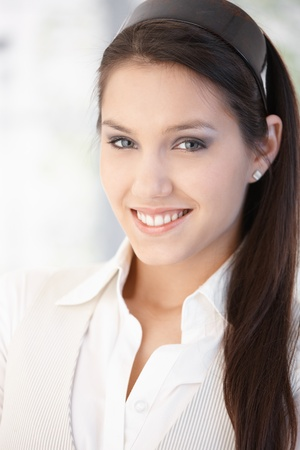 Portrait of pretty young girl smiling happily. photo