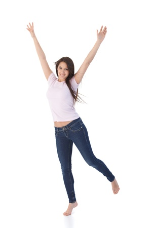 Young attractive woman jumping up happily.