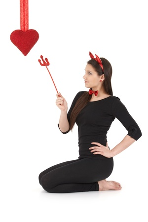 Pretty woman wearing devil costume at valentine's day. Stock Photo - 9298947