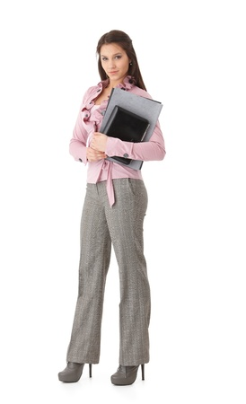 Pretty young businesswoman holding folders and personal organizer, smiling. photo
